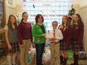 8th graders donate to CAPSEA for Advent service project