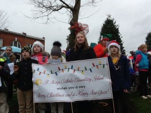 Elementary school students show off their Christmas spirit
