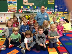 Firefighter teaches preschoolers about safety during Fire Prevention Week