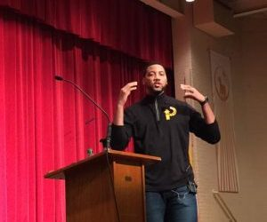 Current and former professional athletes speak during assembly at ECCHS