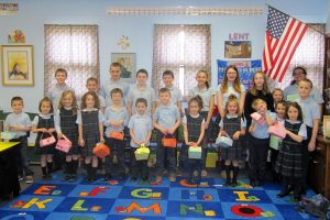 St. Leo students help their younger peers during Holy Week